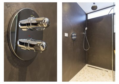 Badkamer microcement wanden met kranen