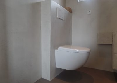 Toilet microcement wanden en vloer